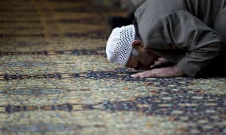 A muslim man prays during a prayer sessi