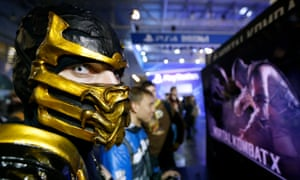 A Russia Comic-Con fan dressed as the Mortal Kombat game character Scorpion eyes his surroundings