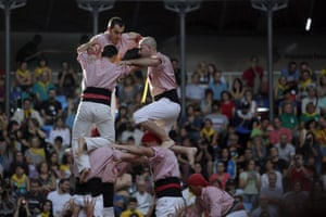 Appearance of a human tower built by a Catalan colle while participating in the 25th edition of the 'Contest Castells', which is held every two years in Tarragona, the world's largest casteller show