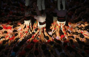 """Castellers Colla Jove Xiquets de Tarragona anchor the base of a human tower, called """"castell"""", during a biannual competition in Tarragona city"""