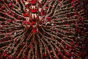 Members of the Castellers Joves Xiquets de Valls try to complete their human tower during the 25th Human Tower Competition in Tarragona