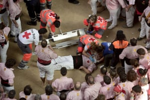"""Red cross personnel attend to an injured member of the """"Xiquets de Tarragona"""" team during the XXV human towers, or castells, competetion in Tarragona."""