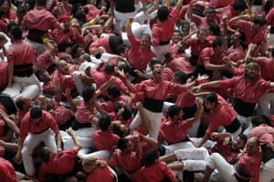 A group of human towers celebrates the successful completion of ITS construction During the 25th edition of the 'Castells Competition' in Tarragona.