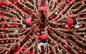 Castellers Colla Joves Xiquets de Valls start to form a human tower called 'castell' during a biannual competition in Tarragona city.