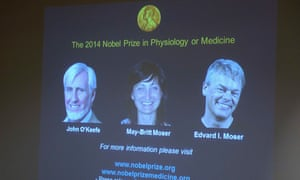 A screen in Stockholm presents the winners of the 2014 Nobel Prize in Medicine, U.S.-British scientist John O'Keefe and Norwegian husband and wife Edvard Moser and May-Britt Moser .