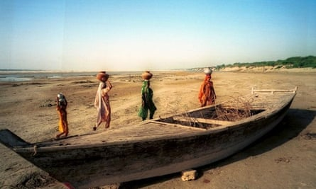 An abandoned  boat on the dry bed of the Indus River