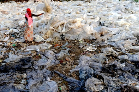 An Indian worker sorts plastics obtained from garbage at a dump on the outskirts of Mumbai.