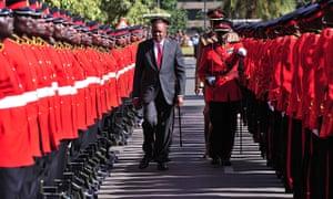 Uhuru Kenyatta reviewing troops before addressing parliament in Nairobi, when he said he would go to