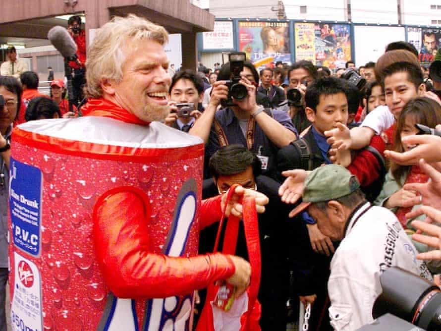 Sir Richard Branson hands out free cans of Virgin Cola in downtown Tokyo. Sales of the brand lost fizz against the might of Coca-Cola and Pepsi.