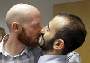 Plaintiffs Moudi Sbeity, right, and his partner Derek Kitchen, one of three couples who brought the lawsuit against Utah's gay marriage ban, kiss following a news conference Monday, Oct. 6, 2014, in Salt Lake City.