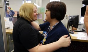 Katie Burris, left, and her partner Evangeline Cook embrace after receiving their marriage license at the Marion County Clerks office in Indianapolis, Monday, Oct. 6, 2014.