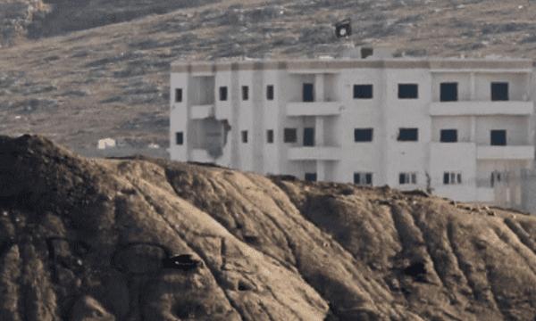 Isis flag outside Kobani