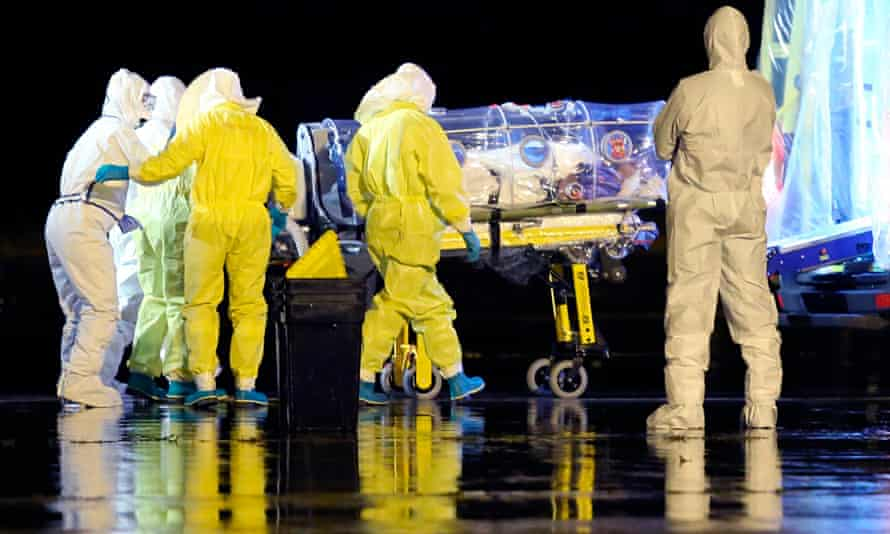 Spanish health workers move Ebola patient Manuel Garcia Viejo into an ambulance