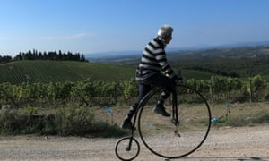 A cyclist rides on a high wheel bicycle to practices a day before the the big race