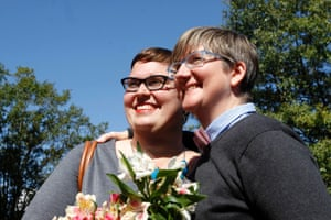 Nicole Pries (L), and Lindsey Oliver pose after they were the first same-sex couple to be wed in a ceremony outside the John Marshall Court's Building in Richmond, Virginia October 6, 2014.