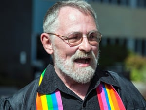 Gay marriage advocate Bruce McKinney waits outside the Sedgwick County Courthouse in Wichita, Kan., Monday, Oct. 6, 2014, in case a gay couple would want him to marry them.