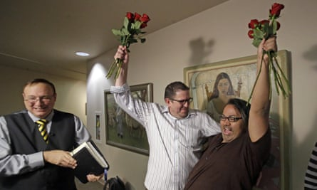 Gregory Enke and Ariel Ulloa celebrate after getting married at the Salt Lake county clerk's office in Salt Lake City.