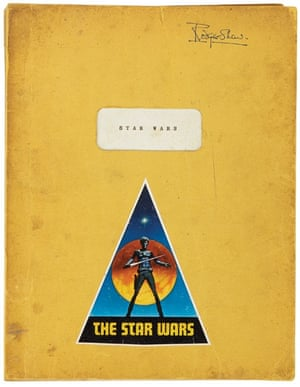 The original cast script from Stars Wars IV: A New Hope, yellow paper-covered script with a triangular 'The Star Wars' sticker fixed to the front cover