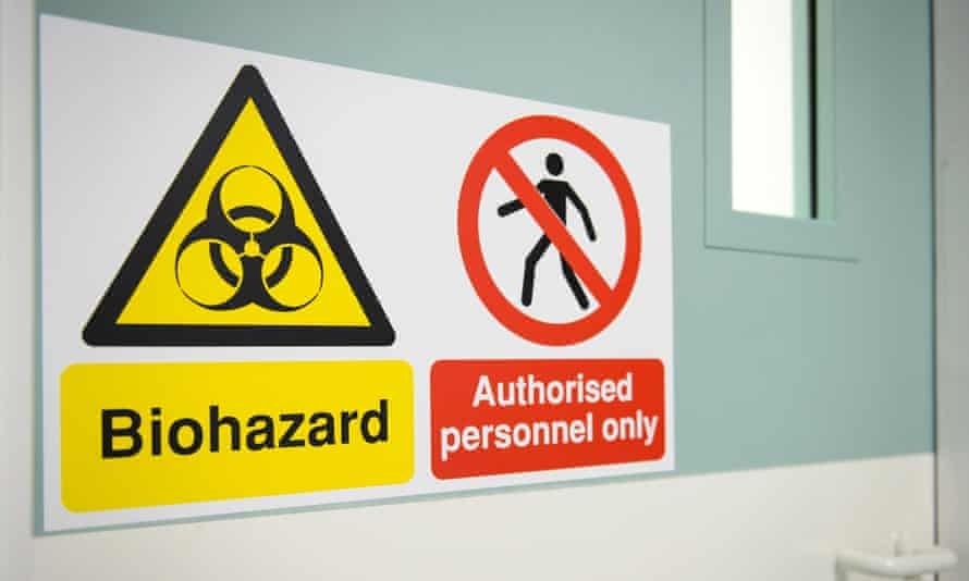 A sign warns of the biohazard threat outside the facilities in place at the Royal Free Hospital in north London on August 6, 2014, in the event of a patient testing positive for the Ebola virus.