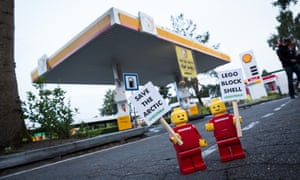 """Greenpeace places 10 LEGO mini activist figures at a Shell gas station in Legoland in Billund, Denmark with banners reading """"Save the Arctic Stop Shell"""". The action is part of a global campaign targeting LEGO, the worlds biggest toy company, to stand up for Arctic protection by ditching Shell as a business partner and take an active stand against Arctic oil destruction."""