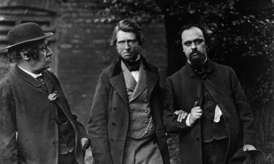 Dante Gabriel Rossetti, right, arm in arm with John Ruskin as William Bell Scott looks at them.