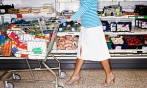 Supermarket shopper with a full trolley