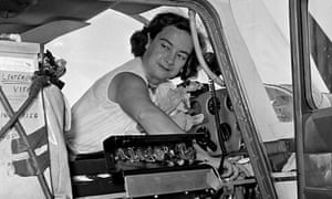 Jerrie Mock checking her gas tanks in 1964.