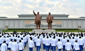 North Korean athletes pay tribute to Kim Il-sung and Kim Jong-il in Pyongyang on their return from the Asian Games.