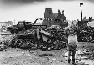 A young traveller girl stands amid the rubble of a cleared area of dilapidated terraced housing in Manchester. 1968