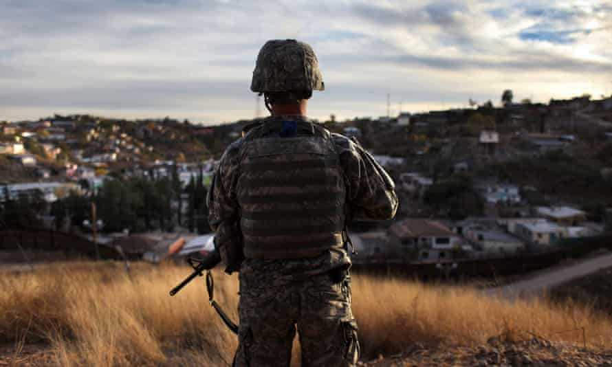 An Arizona National Guardsman watches over the US border with Mexico.