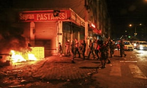 Kurdish protesters are pictured in a street on October 7, 2014 in the southeastern city of Diyarbakir during a demonstration to demand more western intervention against Islamic State militants (IS) in Syria and Iraq.