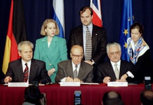 President Slobodan Milosevic of Serbia (L), President Alija Izetbegovic of Bosnia-Herzegovina (C) and President Franjo Tudjman of Croatia sign the Dayton Agreement peace accord at the Hope Hotel inside Wright-Patterson Air Force Base in this November 21, 1995.