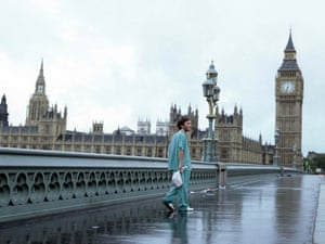 Jim (Cillian Murphy) walks distractedly across Westminster bridge with Parliament in the background,  as he survives a virus that wipes out most of the Earth's population in a still from the film 28 Days Later.