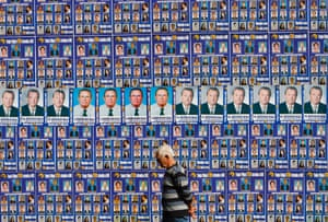 A man walks past a wall decorated with posters of political parties and candidates for the parliamentary elections in central Sarajevo September 28, 2010.