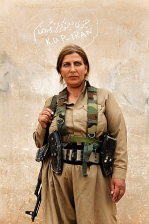 Portrait of a Kurdish woman Peshmerga inside the camp of Kurdistan Democratic Party of Iran.
