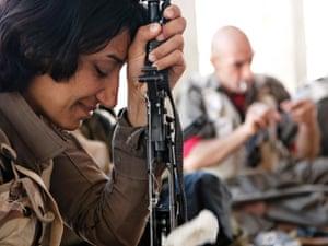 Kurdish peshmergas learn how to use guns in the military training camp of the Komala party of Iranian Kurdistan