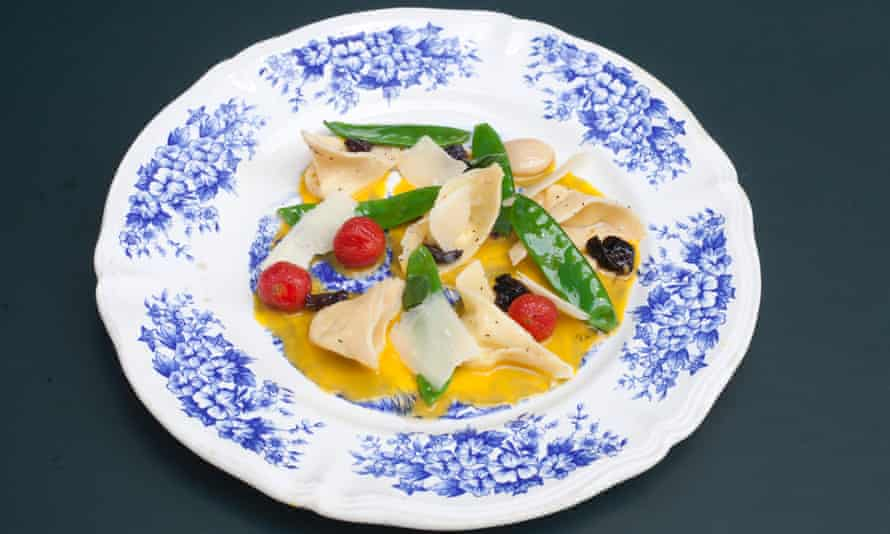 Tortellini filled with labneh on a round plate with blue pattern