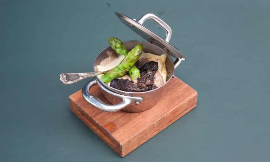 Mini polenta in a metal pot with the lid ajar