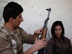 Kurdish peshmergas learn to how to use a gun inside the military training camp of the Komala party of Iranian Kurdistan, Sulaymaniyah, 2012.