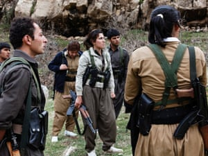 A group of peshmerga who have recently finished their military training test their guns inside the Iranian Communist party of Komala's camp in Sulaymaniyah province.