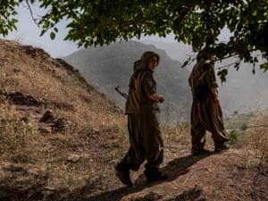 Two women PJAK guerrillas walk through the Qandil mountains, Kurdistan, 2013.