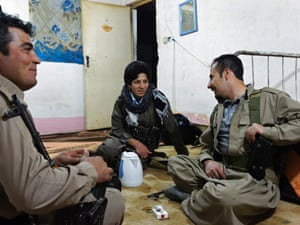 Kwestan, 22, talks with her fellow comrades after their night shift of guarding the Komala party of Iranian Kurdistan camp in Sulaymaniyah province.