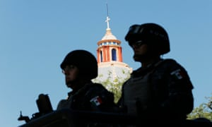 Mexican federal police officers on patrol in Iguala