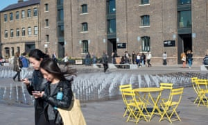 'Children from surrounding estates run through Granary Square's fountains unchecked by security guards.'