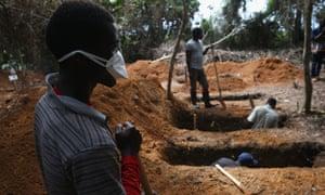Grave diggers prepare for new Ebola victims outside an Ebola treatment centre near Gbarnga, central Liberia.