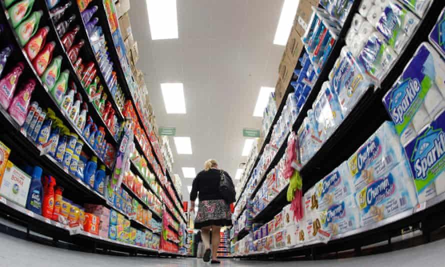 shopper walking down aisle in walmart store