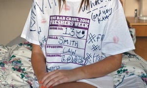 A woman wearing a signed freshers' week T-shirt
