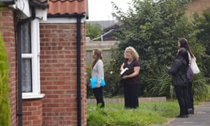 Council officers on a house inspection in Wisbech. Photograph: Andy Hall for the Guardian