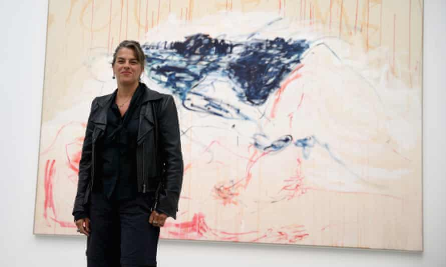 Tracey Emin posing in front a work that forms part of  The Last Great Adventure is You.