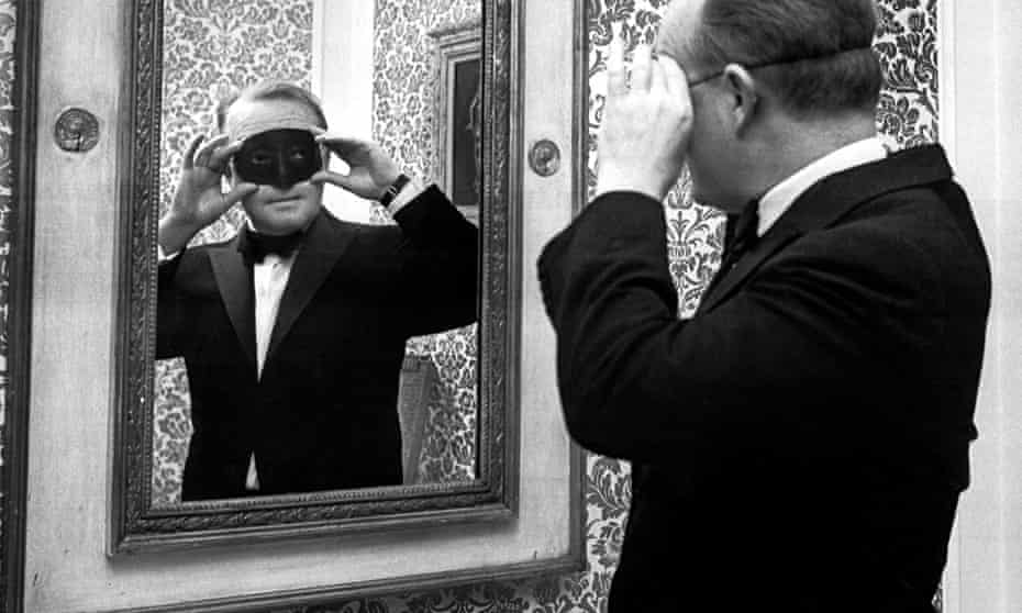Truman Capote wears a mask for a costume ball at the Plaza hotel, New York, in 1966